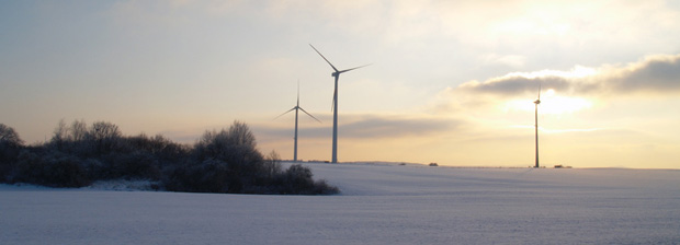 Wind turbines in a winter landscape.
