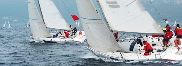 Sailboats racing in a competition.