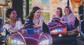 Four young women in bumper cars.