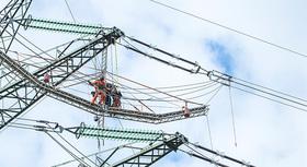 Engineers inspecting power lines.