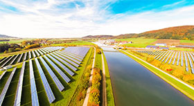 Cultivaed landscape with canal and solar farms.