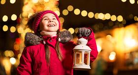 Little girl with christmas lantern.