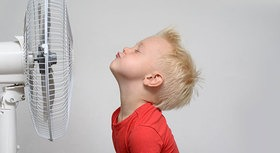 Child in front of a fan.