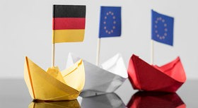 Paper ships showing German and European flags.