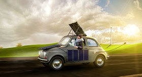woman in a small car with solar panels on roof
