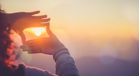 Two hands holding the sun